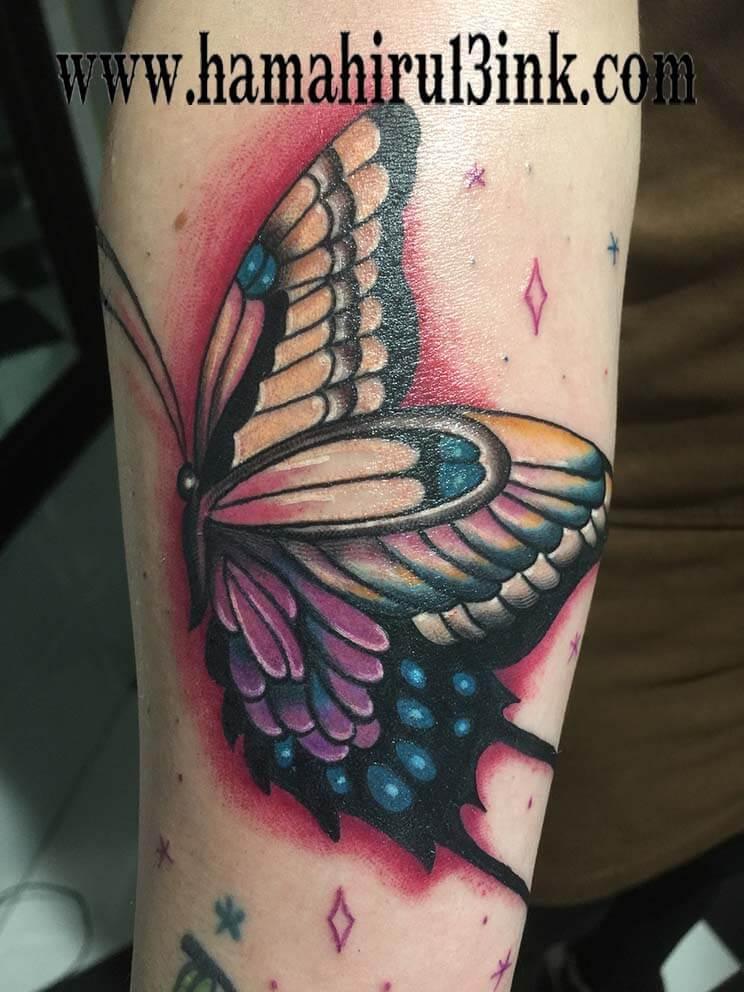 Tatuaje mariposa Hamahiru 13 Ink Tattoo & Piercing