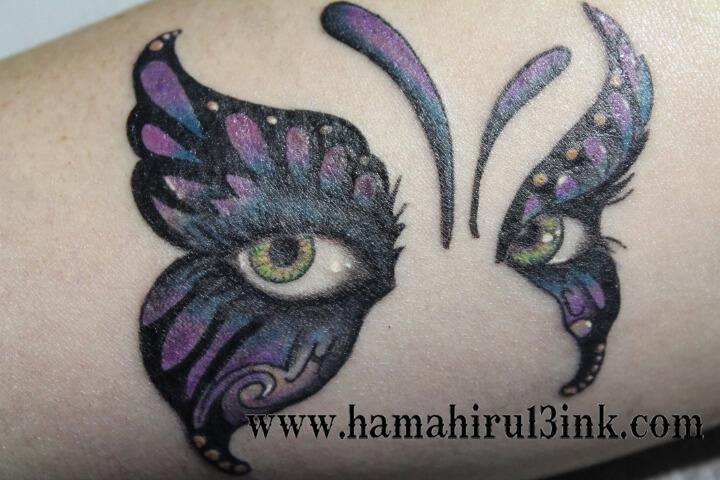 Tatuaje mariposa en brazo Hamahiru 13 Ink Tattoo & Piercing