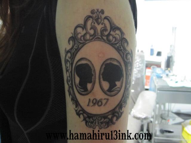 Tatuaje en brazo Hamahiru 13 Ink Tattoo & Piercing
